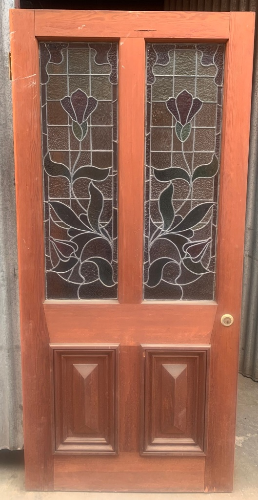 Leadlight in the large cricket bat front door , stylised flower and foliage panels in mirror image, 950 mm x 2055 mm , $950 salvaged, recycled, demolition, reproduction, restoration, renovation,collectable, secondhand, used , original, old, reclaimed, heritage, antique, victorian, art nouveau edwardian, georgian, art deco