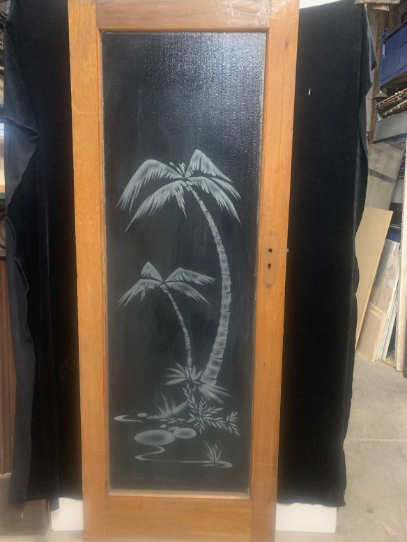 Glass door with etched palm trees , clear glass, black back drop was for the photo, 770 mm x 2035 mm , $ 345 salvaged, recycled, demolition, reproduction, restoration, home renovation secondhand, used , original, old, reclaimed, heritage, antique, victorian, art nouveau edwardian, georgian, art deco