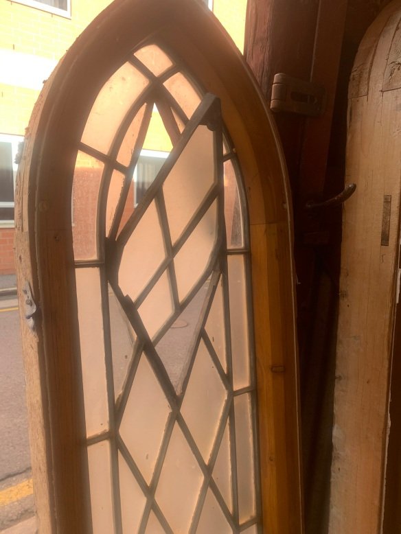 v salvagedDetail of pivot window in the Pair of Elegant narrow arch church windows , leadlight, 405 mm x 1865 mm , $785 each , 2 matching available, recycled, demolition, reproduction, restoration, home renovation secondhand, used , original, old, reclaimed, heritage, antique, victorian, art nouveau edwardian, georgian, art deco