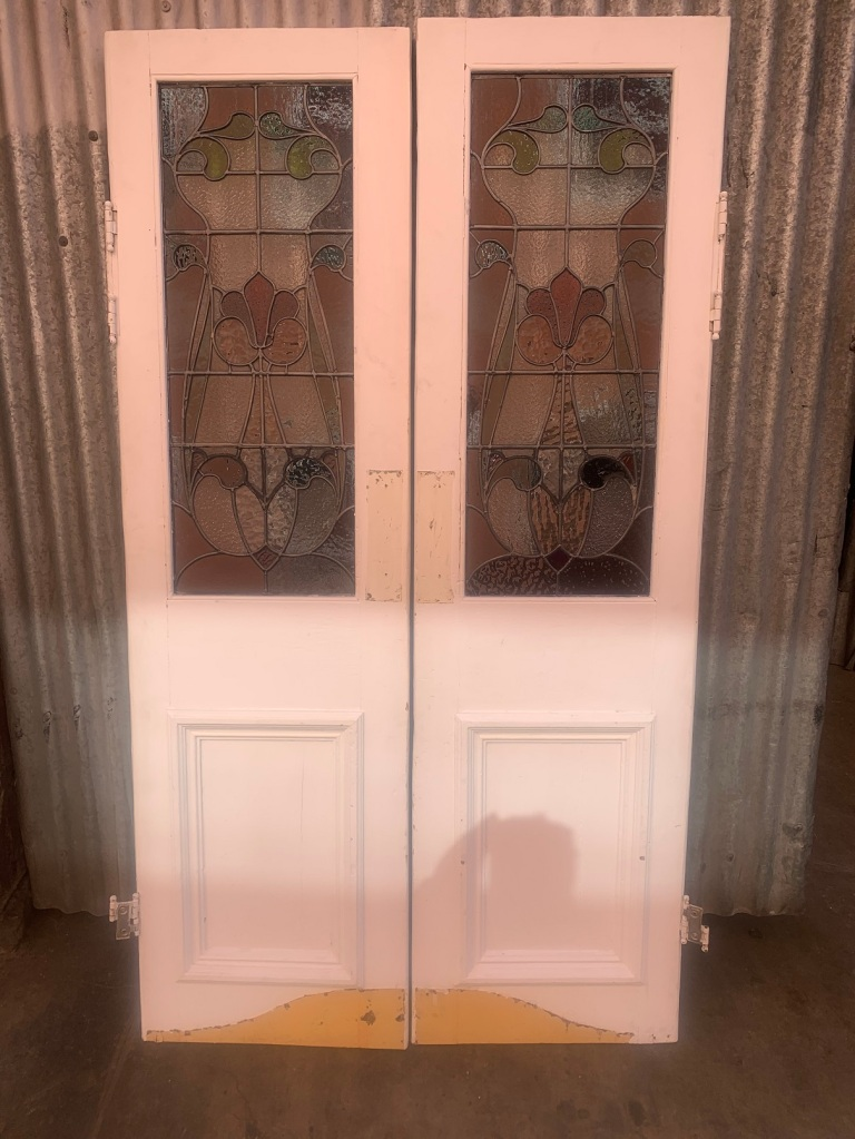 Pair of French doors with swing hinges and leadlight panels , floral Art Nouveau design, 1130 mm wide x 1970 mm tall , $845 the pair r salvaged, recycled, demolition, reproduction, restoration, home renovation secondhand, used , original, old, reclaimed, heritage, antique, victorian, art nouveau edwardian, georgian, art deco