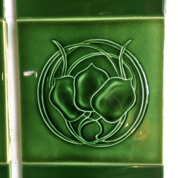 Detail of Art Nouveau feature tiles 6 x 6 inch, circa 1905, monochrome green glaze, three stylised flowers in circular foliage, two panel fireplace tile set, $325 OTB 28Art Nouveau feature tiles 6 x 6 inch, circa 1905, monochrome green glaze, three stylised flowers in circular foliage, two panel fireplace tile set, $325 OTB 28