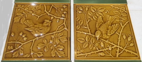 Detail of original Mintons China Works high relief embossed tiles circa 1895 in old gold glaze. Two designs of birds in rose branches with rosehips 6x6 inch Two panel set $485 OTB 34 salvaged, recycled, demolition, reproduction, restoration, home renovation secondhand, used , original, old, reclaimed, heritage, antique, victorian, art nouveau edwardian, georgian, art deco Detail of original Minton high relief embossed tiles circa 1895 in old gold glaze. Two designs of birds in rose branches with rosehips 6x6 inch Two panel set $485 OTB 34