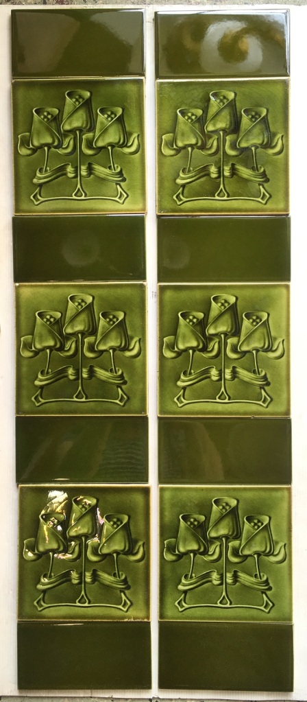 T and R Boote, England, circa 1905, Art Nouveau tiles 6x6 inch. triple tulip design, molded tiles with monochrome olivy-green glaze, two panel fireplace set, $340 SET 159 (additional 4 tulip tiles available if wanting 10 feature tiles)