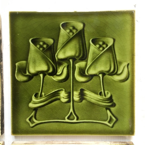 detail of T and R Boote, England, circa 1905, Art Nouveau tiles 6x6 inch. triple tulip design, molded tiles with monochrome olivy-green glaze, two panel fireplace set, $340 SET 159 (additional 4 tulip tiles available if wanting 10 feature tiles) salvaged, recycled, demolition, reproduction, restoration, home renovation secondhand, used , original, old, reclaimed, heritage, antique, victorian, art nouveau edwardian, georgian, art deco detail of T and R Boote, England, circa 1905, Art Nouveau tiles 6x6 inch. triple tulip design, molded tiles with monochrome olivy-green glaze, two panel fireplace set, $340 SET 160 (additional 4 tulip tiles available if wanting 10 feature tiles)