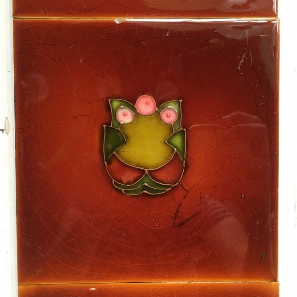 H. Richards Tile Co, England, c 1902-1909, hand tubelined design in clay slip, petite design, Art Nouveau stylised flowers and foliage in pink and green, warm brown glaze, two panel fireplace set $160 SET 162 salvaged, recycled, demolition, reproduction, restoration, home renovation secondhand, used , original, old, reclaimed, heritage, antique, victorian, art nouveau edwardian, georgian, art deco