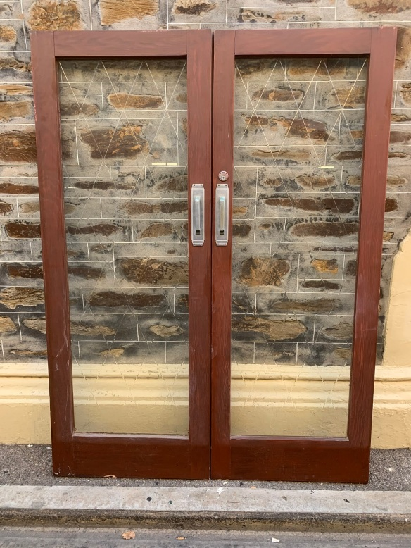 Pair of French doors with cut glass in a diamond pattern, comes with wrought iron screen doors that have the same diamond pattern mirroring the doors , 1555 mm wide x 2080 mm tall , $750 the set , glass doors and screen doors salvaged, recycled, demolition, reproduction, restoration, home renovation secondhand, used , original, old, reclaimed, heritage, antique, victorian, art nouveau edwardian, georgian, art deco