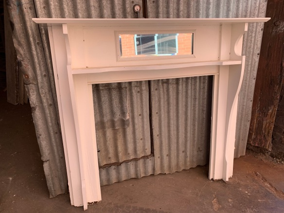 Kauri pine mantle piece, painted with bevelled mirror , top shelf is 1445 mm x 220 mm , height is 1275 mm , opening is 920mm wide x 910mm high, $330 salvaged, recycled, demolition, reproduction, restoration, home renovation secondhand, used , original, old, reclaimed, heritage, antique, victorian, art nouveau edwardian, georgian, art deco