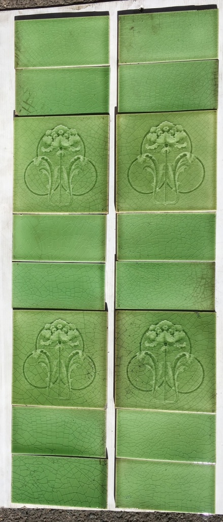 salvaged, recycled, demolition, reproduction, restoration, home renovation secondhand, used , original, old, reclaimed, heritage, antique, victorian, art nouveau edwardian, georgian, art deco T and R Boote tiles England, circa 1900, molded flower (iris?) design, monochrome soft green glaze. 'Seasoned' condition though still appealing. $200 for the two panel fireplace set SET 174