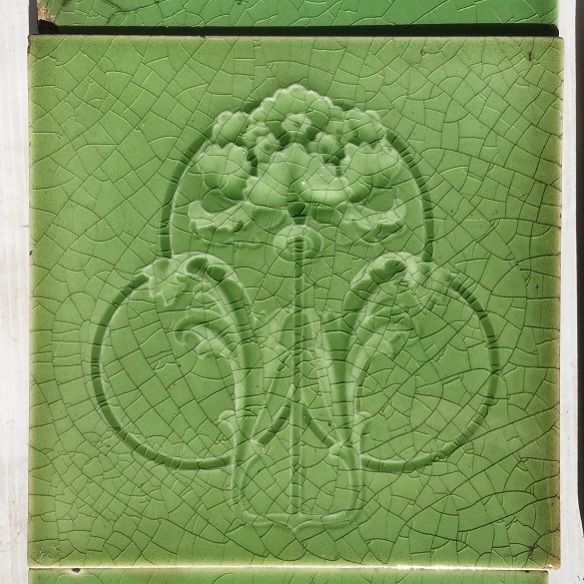 salvaged, recycled, demolition, reproduction, restoration, home renovation secondhand, used , original, old, reclaimed, heritage, antique, victorian, art nouveau edwardian, georgian, art deco Detail of T and R Boote tiles England, circa 1900, molded flower (iris?) design, monochrome soft green glaze. 'Seasoned' condition though still appealing. $200 for the two panel fireplace set SET 174