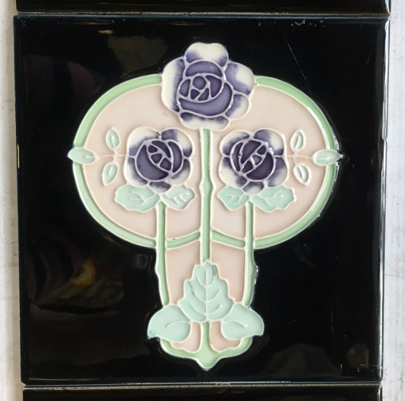 salvaged, recycled, demolition, reproduction, restoration, home renovation secondhand, used , original, old, reclaimed, heritage, antique, victorian, art nouveau edwardian, georgian, art deco Detail of Reproduction Aesthetic / Art Nouveau tiles, three lavender roses on very deep teal blue background, appears black in most lights. $150, OTB 38