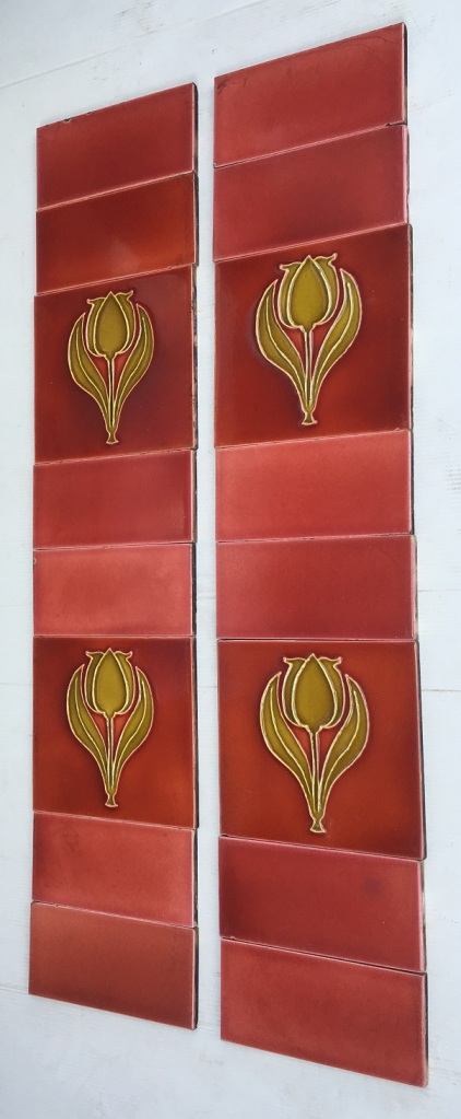 Original Sherwin and Cotton fireplace tile set, circa 1900, moulded tulip design in deep warm yellow, light burgundy background, 153 x 153mm, $240 OTB 42
