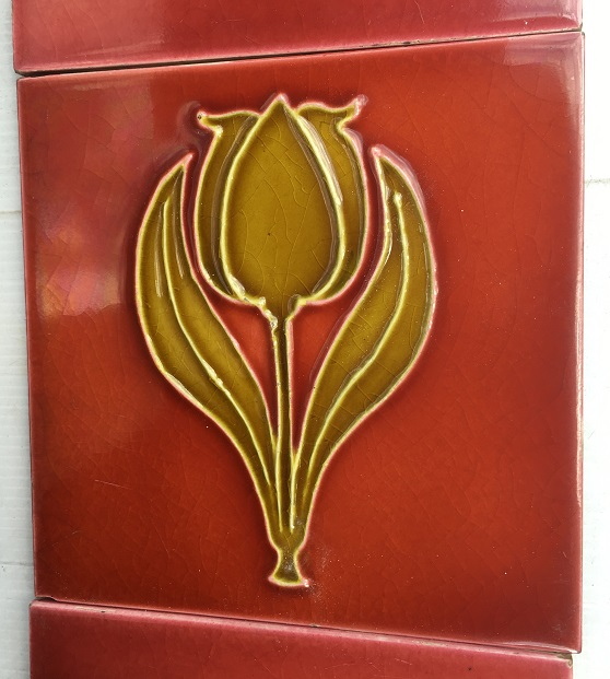Detail of original Sherwin and Cotton fireplace tile set, circa 1900, moulded tulip design in deep warm yellow, light burgundy background, 153 x 153mm, $240 salvaged, recycled, demolition, reproduction, restoration, home renovation secondhand, used , original, old, reclaimed, heritage, antique, victorian, art nouveau edwardian, georgian, art deco