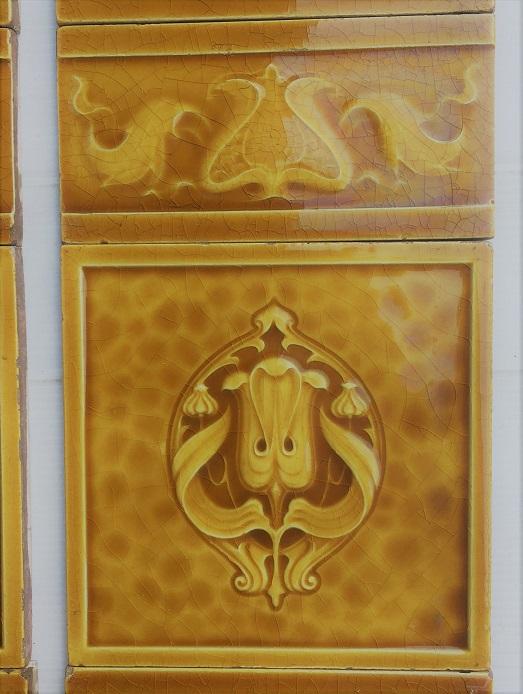 Detail of H and R Johnson, England, c 1910, Art Nouveau moulded feature and half tiles in honey colour glaze, $330 SET 180 salvaged, recycled, demolition, reproduction, restoration, home renovation secondhand, used , original, old, reclaimed, heritage, antique, victorian, art nouveau edwardian, georgian, art deco