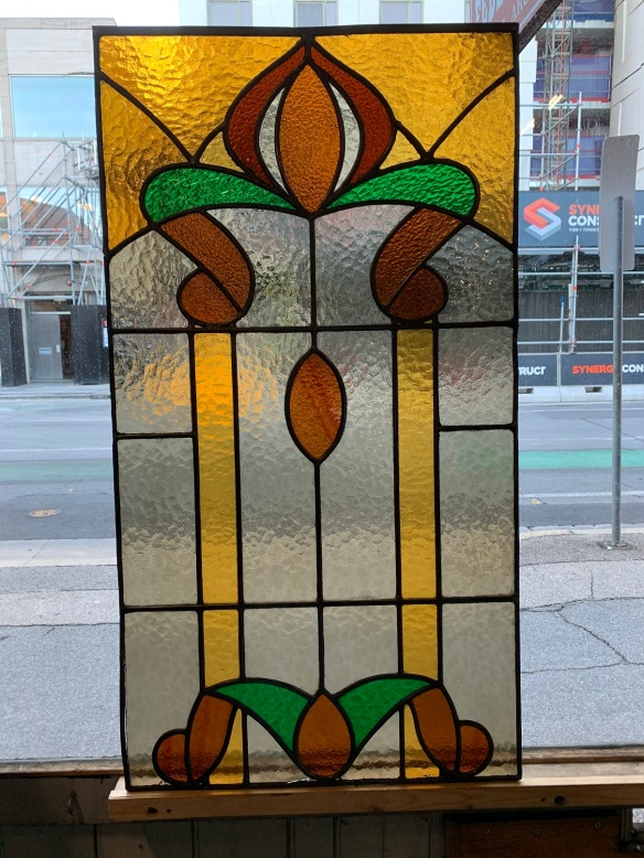 salvaged, recycled, demolition, reproduction, restoration, home renovation secondhand, used , original, old, reclaimed, heritage, antique, victorian, art nouveau edwardian, georgian, art decoLeadlight panel with amber , green and red glass , 1055 mm x 570 mm , $ 445