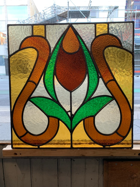 salvaged, recycled, demolition, reproduction, restoration, home renovation secondhand, used , original, old, reclaimed, heritage, antique, victorian, art nouveau edwardian, georgian, art decoLeadlight panel with amber , green , brown and red glass , 575 mm high x 570 mm $ 220