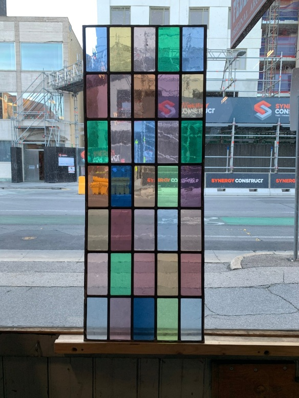 salvaged, recycled, demolition, reproduction, restoration, home renovation secondhand, used , original, old, reclaimed, heritage, antique, victorian, art nouveau edwardian, georgian, art decoLeadlight panel with multi coloured rectangles , 955 mm x 370 mm , $ 345