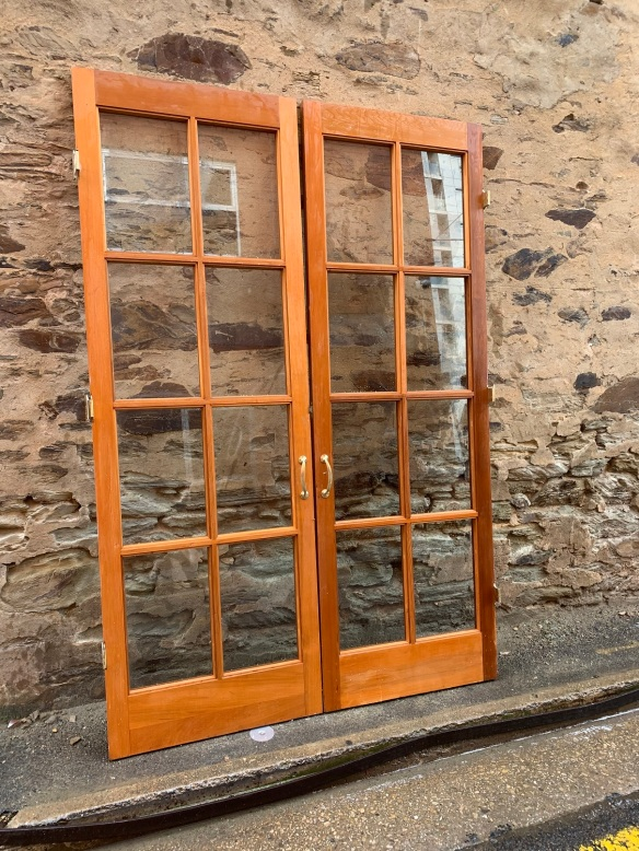 salvaged, recycled, demolition, reproduction, restoration, home renovation secondhand, used , original, old, reclaimed, heritage, antique, victorian, art nouveau edwardian, georgian, art decoLarge pair of western red cedar french doors, with parliament hinges and brass handles , total width is 1740 mm x 2585 mm tall , $ 795 the pair