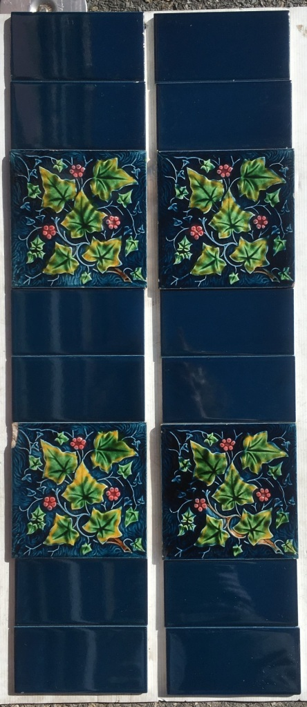 Late Victorian ivy pattern moulded fireplace tiles green leaves,pink berries on deep blue ground. Two panel set, $230 OTB 184 salvaged, recycled, demolition, reproduction, restoration, home renovation secondhand, used , original, old, reclaimed, heritage, antique, victorian, art nouveau edwardian, georgian, art deco