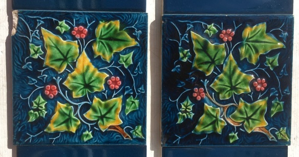 Detail of late Victorian ivy pattern moulded fireplace tiles green leaves,pink berries on deep blue ground. Two panel set, $230 OTB 184 washstandsalvaged, recycled, demolition, reproduction, restoration, home renovation secondhand, used , original, old, reclaimed, heritage, antique, victorian, art nouveau edwardian, georgian, art deco