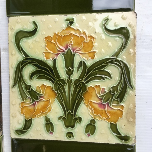 Rare Art Nouveau, majolica feature tiles c1905, stylised carnations in yellow with unusual moulded background, on white clay. Two panel fireplace set $280 OTB 61 salvaged, recycled, demolition, reproduction, restoration, home renovation secondhand, used , original, old, reclaimed, heritage, antique, victorian, art nouveau edwardian, georgian, art deco