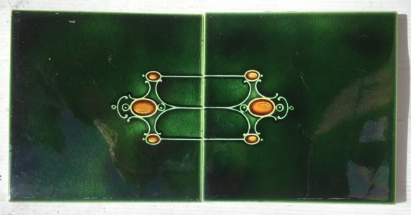 Pair of Victorian feature tiles, rich green with moulded detail in amber $50 pair WS salvaged, recycled, demolition, reproduction, restoration, home renovation secondhand, used , original, old, reclaimed, heritage, antique, victorian, art nouveau edwardian, georgian, art deco