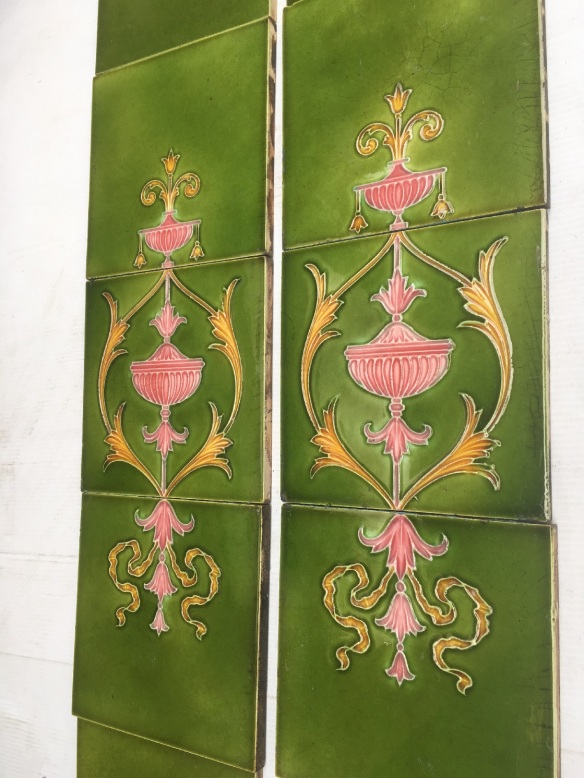 salvaged, vintage recycled, demolition, reproduction, restoration, home renovation secondhand, used , original, old, reclaimed, heritage, antique, victorian, art nouveau edwardian, georgian, art deco Original late Victorian period fireplace tiles, circa 1895, continuous pattern over three tiles, classical design, urns, foliage and scrolls. pink and yellow detail on mid green glaze. Two panel fireplace set $390 OTB 69