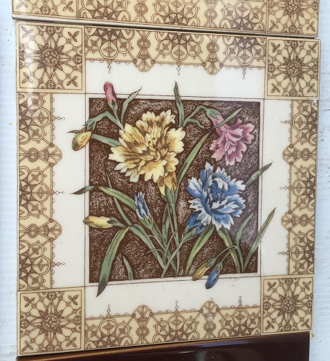 detail of reproduction Johnson, England, fireplace tile panels, Aesthetic style brown tines with carnations in pink, yellow, blue. 2 panels $260 OTB 56 salvaged, recycled, demolition, reproduction, restoration, home renovation secondhand, used , original, old, reclaimed, heritage, antique, victorian, art nouveau edwardian, georgian, art deco