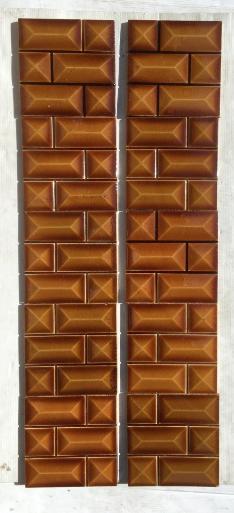Late Victorian fireplace tiles c1895, each 153 x 153mm tile moulded with rows of small brick pattern. bevelled shape to each mini brick. Translucent amber coloured glaze. Two panel set. $300 SET 192 salvaged, recycled, demolition, reproduction, restoration, home renovation secondhand, used , original, old, reclaimed, heritage, antique, victorian, art nouveau edwardian, georgian, art deco