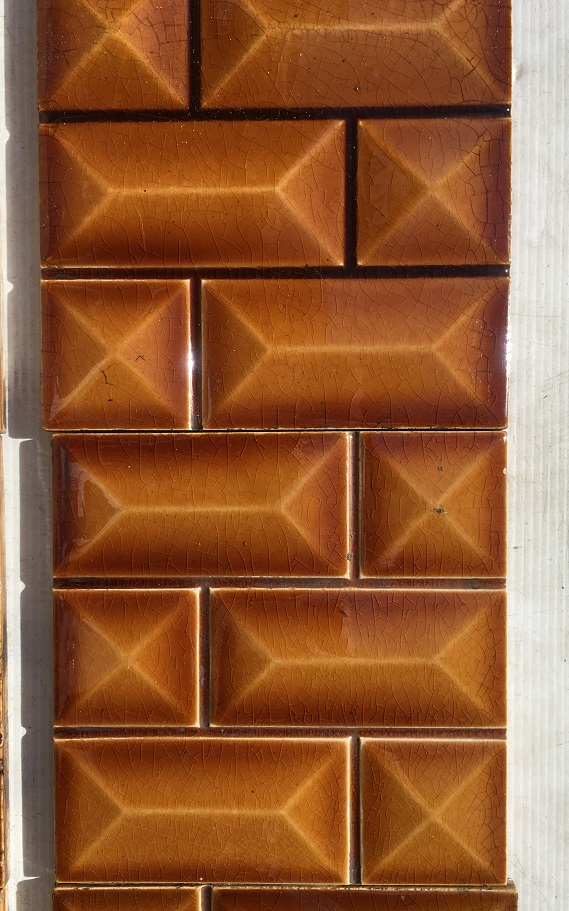 Detail of Late Victorian fireplace tiles c1895, each 153 x 153mm tile moulded with rows of small brick pattern. bevelled shape to each mini brick. Translucent amber coloured glaze. Two panel set. $300 SET 192 salvaged, recycled, demolition, reproduction, restoration, home renovation secondhand, used , original, old, reclaimed, heritage, antique, victorian, art nouveau edwardian, georgian, art deco