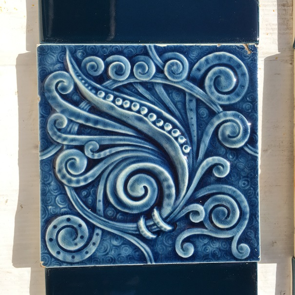 salvaged, vintage recycled, demolition, reproduction, restoration, home renovation secondhand, used , original, old, reclaimed, heritage, antique, victorian, art nouveau edwardian, georgian, art deco Late 1800s feature tiles, American Encaustic Tile Co. spiral and scrolls design, stylised foliage with finely detailed spirals in background, deep blue glaze, $460 for two panel set, can separate to have 2 or 4 tiles in the fireplace panels. $460 OTB 67