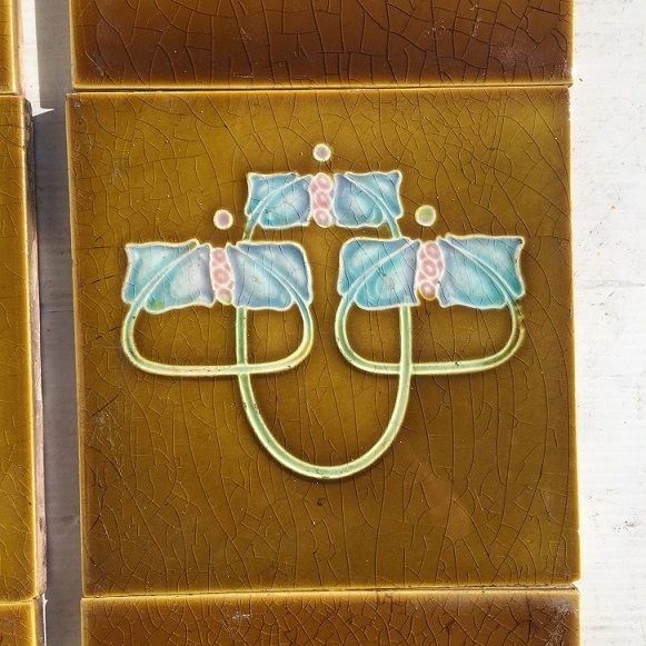 Detail original Henry Richards feature tile set, c 1912, embossed majolica, 152 x 152mm, two panel set (four feature tiles) $220 SET 197 restoration, home renovation secondhand, used , original, old, reclaimed, heritage, antique, victorian, art nouveau edwardian, georgian, art deco