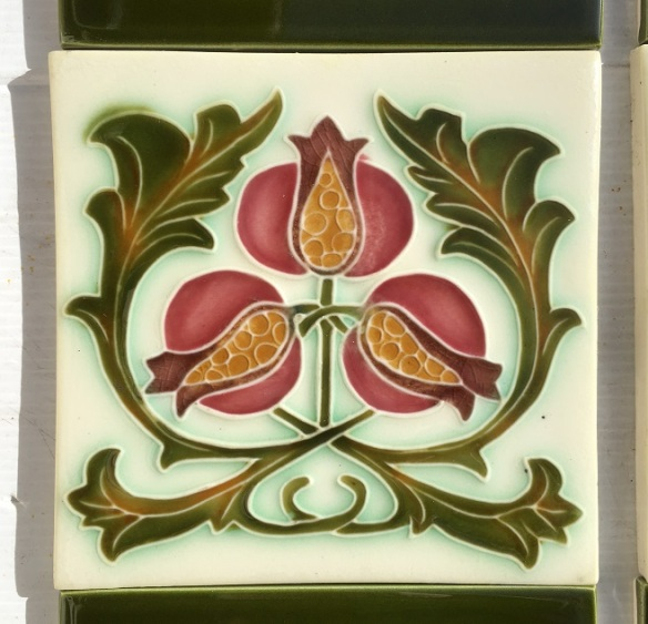 Design of three pomegranates with green foliage on reproduction fireplace feature tiles 150 x 150mm, two panel fireplace set, $145 OTB 65salvaged, recycled, demolition, reproduction, restoration, home renovation secondhand, used , original, old, reclaimed, heritage, antique, victorian, art nouveau edwardian, georgian, art deco