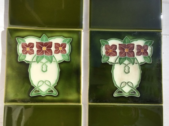 Art Nouveau style reproduction fireplace feature tiles 152 x 152mm, trio of dusky pink flowers on olive green ground. One feature tile is lighter in colour. Two panel set $120 OTB 62 salvaged, recycled, demolition, reproduction, restoration, home renovation secondhand, used , original, old, reclaimed, heritage, antique, victorian, art nouveau edwardian, georgian, art deco