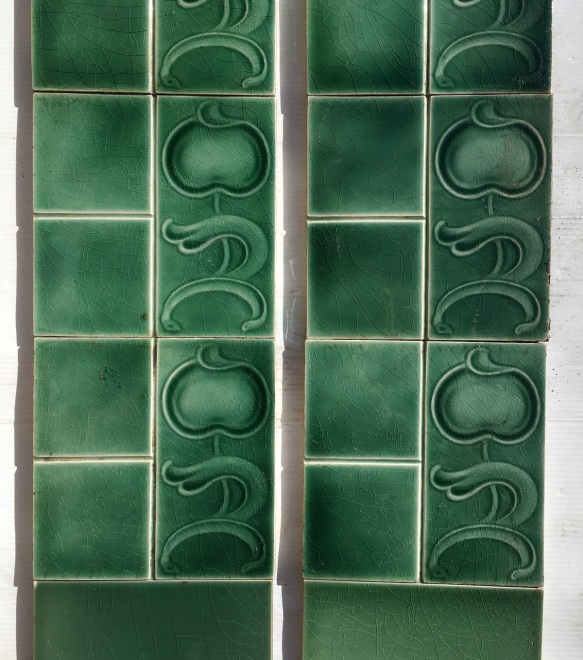Sherwin and Cotton, England tiles, c1905. moulded Art Nouveau design, monochrome green glaze, Two panel fireplace set $250 SET 202salvaged, vintage recycled, demolition, reproduction, restoration, home renovation secondhand, used , original, old, reclaimed, heritage, antique, victorian, art nouveau edwardian, georgian, art deco