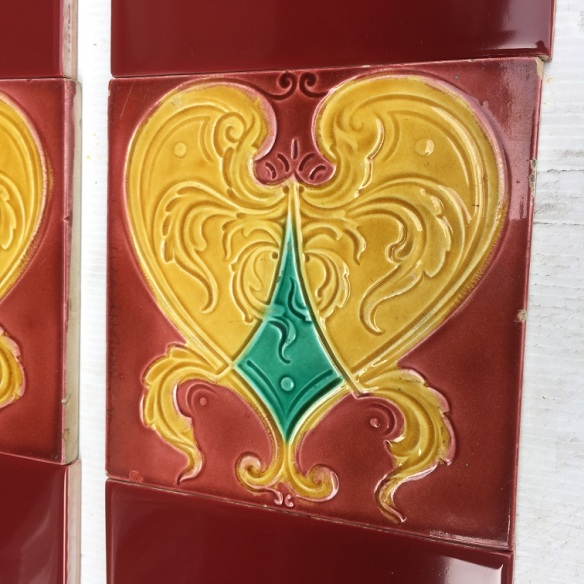c1900 Lea and Boulton feature tiles, burgundy background, golden yellow stylised heart shape with teal green, two panel fireplace set, $180 salvaged, recycled, demolition, reproduction, restoration, home renovation secondhand, used , original, old, reclaimed, heritage, antique, victorian, art nouveau edwardian, georgian, art deco