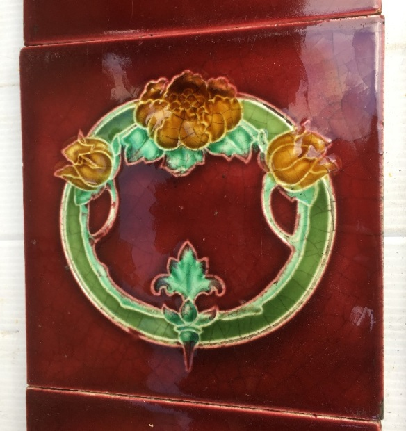 Detail of original T and R Boote, England, c1905 fireplace tile set, 6 x 6 inch circular floral design and 3 x 6 inch decorative tiles, rich burgundy glaze with deep yellow flowers, green foliage. Two panel fireplace set, $350 OTB 80 vintagesalvaged, recycled, demolition, reproduction, restoration, renovation,collectable, secondhand, used , original, old, reclaimed, heritage, antique, victorian, art nouveau edwardian, georgian, art deco