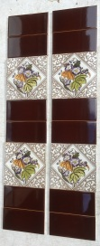 Late Victorian feature tiles c 1895, hand tinted print, deep brown print on white clay ground with purple edged flowers and foliage in greens. Two panel fireplace set,