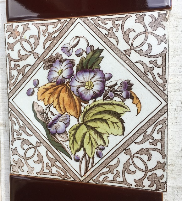 Late Victorian Aesthetic era feature tiles c1895, hand tinted print, floral, chocolate brown print on white glaze, purple flowers with foliage. two panel fireplace set, $260 OTB 79