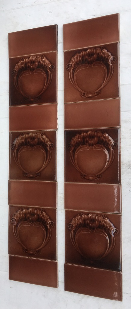 Original moulded tile, monochrome brown to madder brown colour glaze, c1910., stylised wreath / scroll / flower design. two panel fireplace set $260 OTB 88 salvaged, vintage recycled, demolition, reproduction, restoration, home renovation secondhand, used , original, old, reclaimed, heritage, antique, victorian, art nouveau edwardian, georgian, art decoDetail of Deco style lettering to pub door