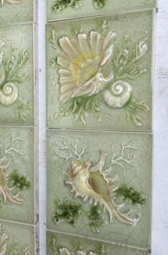 detail of Late 1800s American Encaustic Tile Co. sea shell tiles. Two shell designs in soft greens, two panel fireplace set, (can separate in pairs) $480 SET 215 washstand tiles salvaged, vintage recycled, demolition, reproduction, restoration, home renovation secondhand, used , original, old, reclaimed, heritage, antique, victorian, art nouveau edwardian, georgian, art decoDetail of Deco style lettering to pub door