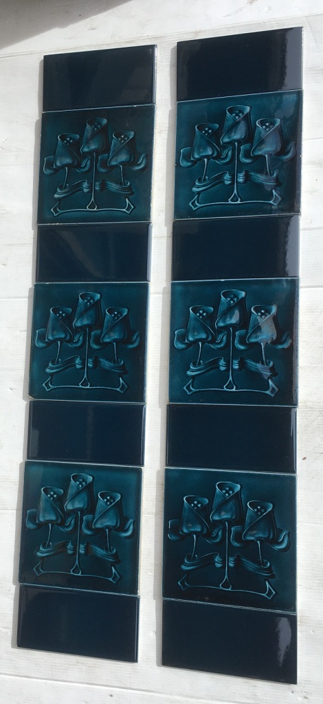 Original Art Nouveau feature tiles T and R Boote, England c 1905, trio of stylised tulips, moulded tile with midnight blue glaze, two panel fireplace set, can be separated into pair $340 SET 211 salvaged, recycled, demolition, reproduction, restoration, renovation,collectable, secondhand, used , original, old, reclaimed, heritage, antique, victorian, art nouveau edwardian, georgian, art deco