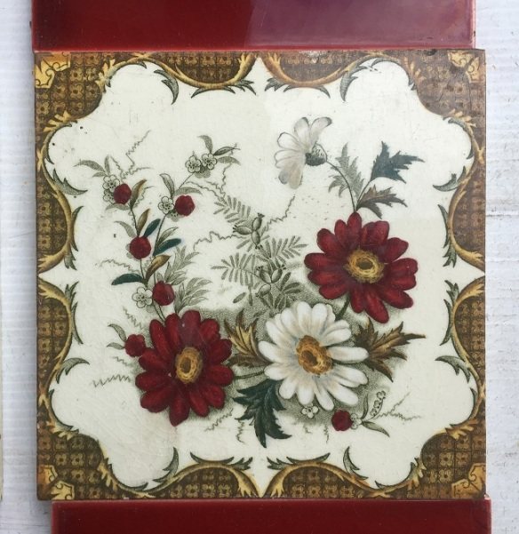 c1900 Booth, England feature tiles with original rich burgundy 3 x 6 inch tiles. Hand tinted print, daisies and foliage. White clay base, golden yellows, deep burgundy and green. Two panel set $140. OTB 87 salvaged, vintage recycled, demolition, reproduction, restoration, home renovation secondhand, used , original, old, reclaimed, heritage, antique, victorian, art nouveau edwardian, georgian, art decoDetail of Deco style lettering to pub door