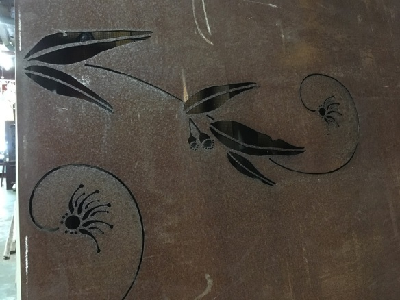 Detail of weathered steel outdoor screen pair, continuous laser cut design, eucalyptus leaves, and parrot with fine scrolls. Heavy panels 3mm thick, with 105mm wide returns for attaching, 1800 x 875mm $450 pair