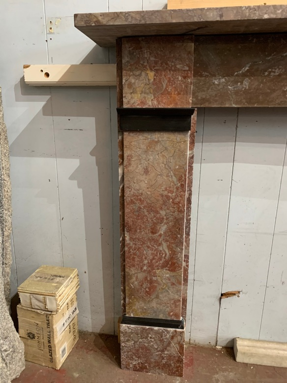 Detail of original Georgian pale rouge marble fireplace mantlepiece with black marble details, top shelf width is 1520 mm x 240 mm , height is 1125 mm , opening is 920mm wide x 91 mm tall, $2500 Rouge , Georgian mantle , top shelf is 1520 mm x 240 mm , height is 1125 mm , opening is 920 mm wide x 915 mm tall , $ 2500salvaged, vintage 1900, 1910s, 1920s 1930 1940s recycled demolition reproduction, restoration, home renovation secondhand, used , original,old,reclaimed,heritage,antique, victorian,art nouveau edwardian, georgian,art deco