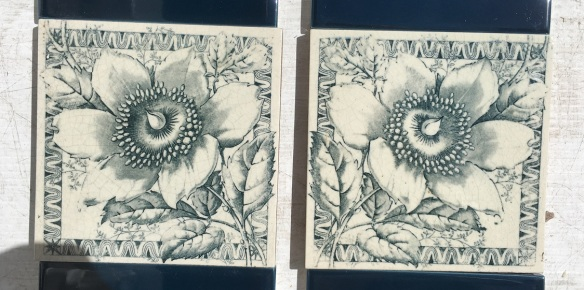 Pair of JH Barratt and co, c1900 English feature tiles, unusual mirrored print, deep blue / grey flower and foliage on white clay base $88 pair SET 235