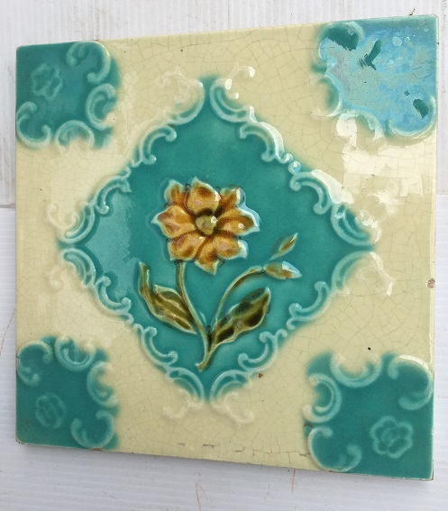 Corn Bros c1900 English feature tiles, honey colour flower on light turquoise and cream ground. Aesthetic style. 7 tiles available $35 each SET 251salvaged, vintage recycled, demolition, reproduction, restoration, home renovation secondhand, used , original, old, reclaimed, heritage, antique, victorian, art nouveau edwardian, georgian, art decoDetail of Deco style lettering to pub door