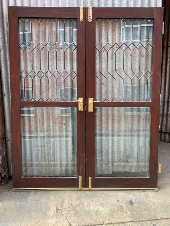 Pair of french doors , Paint finish to exterior , polish to interior ,solid glass to bottom panel , leadlight to upper panel , hinges , barrel bolts and key included , 1630 mm wide x 2000 mm tall , $ 675 the pair