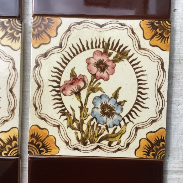 Detail of Late 1800s hand tinted print tiles. Polyanthus flowers with flaming sun motif. One tile has an old repair - possible to disguise to some degree. Can also sell the feature tiles as pairs. Two panel fireplace set $320 SET 223 salvaged, vintage recycled, demolition, reproduction, restoration, home renovation secondhand, used , original, old, reclaimed, heritage, antique, victorian, art nouveau edwardian, georgian, art decoDetail of Deco style lettering to pub door