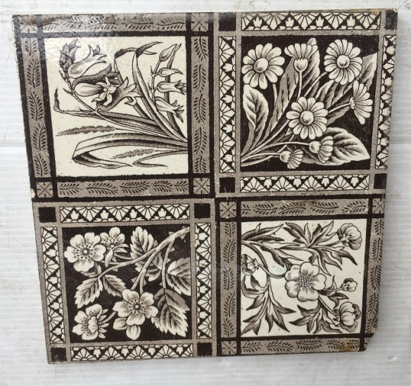 Detail of Circa 1895 English Aesthetic tiles, fine detail in printed design grid of four different flowering plants. very deep brown / charcoal on white clay base , 4 available, $37 each SET 252 , reproduction, restoration, home renovation secondhand, used , original, old, reclaimed, heritage, antique, victorian, art nouveau edwardian, georgian, art decoDetail of Deco style lettering to pub door