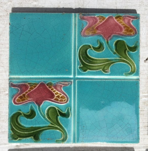 Original Art Nouveau feature tiles, English, stylised pink flowers on aqua blue glaze (there is more of a green tinge to the blue than the photo picks up) $210 whole set SET 250 restoration, home renovation secondhand, used , original, old, reclaimed, heritage, antique, victorian, art nouveau edwardian, georgian, art decoDetail of Deco style lettering to pub door